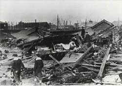 """Sailors search through rubble in Boston's North End following the Great Molasses Flood in 1919, in an image from the book """"Dark Tide"""" by Stephen Puleo. (photo from <a href=""""http://www.boston.com/news/local/articles/2009/03/19/lost_in_a_deadly_flood_and_stirred_by_every_page/"""" target=""""_blank"""">Boston.com article</a>)"""