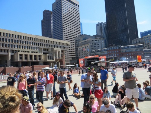 People begin to gather at the blue stage.