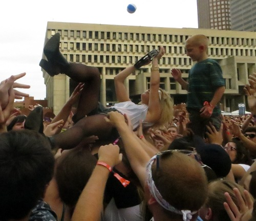 A young fan gets a close up of Anna Bulbrook's crowd surf during Airborne's set at Boston Calling