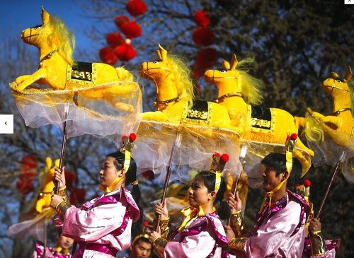 Performers do the horse dance on the evening of the Lunar New Year, or Spring Festival, at a park fair in Beijing (The Independent)